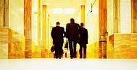 Businessmen Walking Down a Corridor