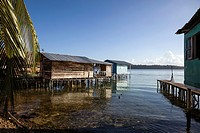 Elevated wooden houses sit over the sea in the Afro-Caribbean town of Old Bank on Isla Bastimentos, Bocas del Toro, Panama