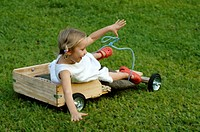 A 4 year old girl falling from her wooden kart