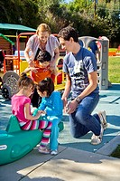 Young and old staff members help blind and crippled children use the playground at the Blind Childrens Learning Center in Santa Ana, CA