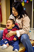 A Hispanic teacher comforts a disoriented frightened vision-impaired boy in a sensory motor group at the Blind Children´s Learning Center in Santa Ana...