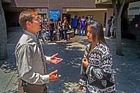 A high school principal and one of his Hispanic senior students talk on the suburban campus in Aliso Viego, CA