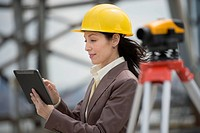 Architect using digital tablet in construction site
