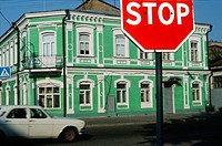 Stop sign and green painted house, Podil district, Kiev, Ukraine