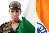 Portrait of female soldier with Indian flag against white background