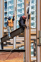 USA, New York, Long Island, New York City, Male workers on construction site