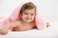Baby girl with pink blanket, smiling (thumbnail)