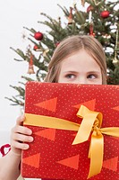Girl holding Christmas gift, close up