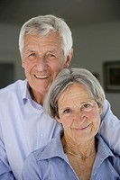 Germany, Bavaria, Senior couple smiling, portrait