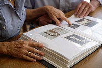 Germany, Bavaria, Senior couple with photo album