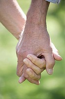 Germany, Bavaria, Senior couple holding hands, close up