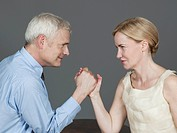 Mature couple arm wrestling