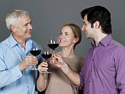 Men and woman with wine glass, smiling