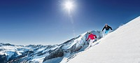 Austria, Salzburg, Young couple skiing on mountain (thumbnail)