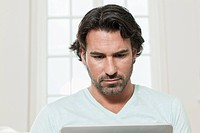 Germany, Berlin, Mature man using laptop