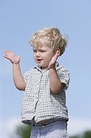 Germany, Bavaria, Boy clapping hands, close up (thumbnail)
