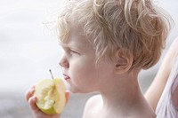 Germany, Bavaria, Mother with boy eating apple
