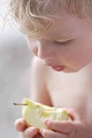 Germany, Bavaria, Boy eating apple, close up