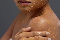 Close_up of woman applying scrub on her body