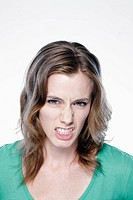 Portrait of angry young woman, studio shot