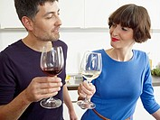 Germany, Cologne, Man and woman drinking wine