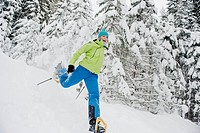 Austria, Salzburg County, Young woman snowshoeing
