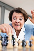 Germany, Leipzig, Senior woman playing chess game