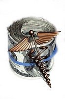 Caduceus and wad of us dollar bills