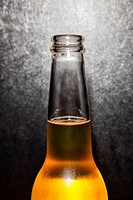Studio shot of glass beer bottle