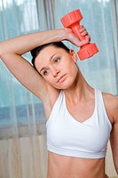 Woman doing exercises with dumbbells.