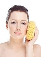 Woman holding sponge.