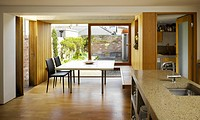 Bricolage & Weathering, Extension & Refurbishment, The Liberties, Ireland. Architect Donaghy + Dimond, 2011. View from kitchen showing seating with ba...