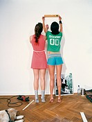 Two Young Women Using Spirit Level