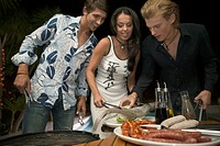 Three Young People Having Barbecue