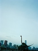 USA, Chicago, skeleton of dinosaur in frond of skyline