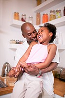 Laughing Father and Daughter in Kitchen