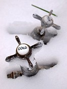 old hot and cold tabs with snow