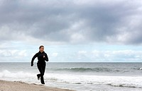teenager running on the beach