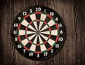 Dartboard hanging on old wooden wall