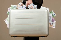 Businessman holding suitcase full of Euro notes (thumbnail)