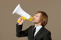 Businessman holding megaphone