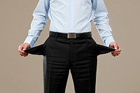 Businessman showing empty trouser pockets