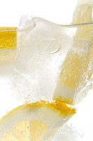 Mineral water with ice cubes and lemon slices