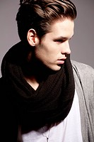 Young man wearing woolen scarf