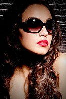 Brunette young woman with lipstick and sunglasses