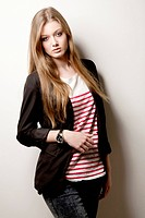 Teenage girl wearing striped top and blazer