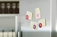 Four adhesive notes attached to refrigerator