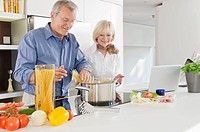 Senior couple preparing healthy pasta meal in kitchen (thumbnail)