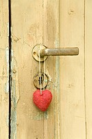 Red heart hanging at door knob