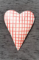 Checkered heart on gray textile